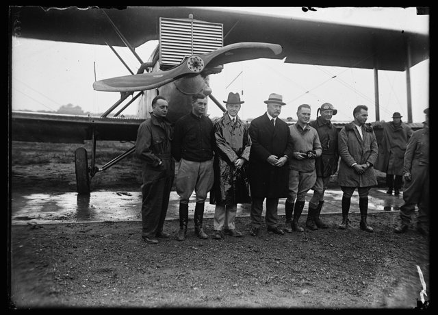 [Calvin Coolidge, John W. Weeks and group in front of airplane]