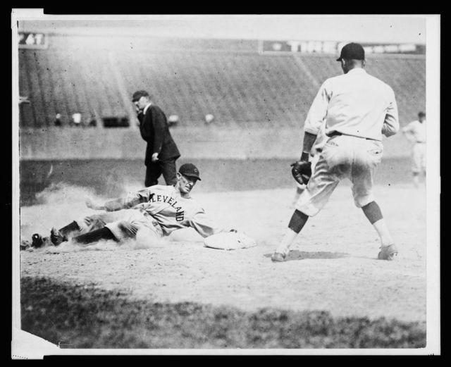 [Cleveland base runner, Chick Fewster, slides safely into 3rd base during baseball game between Cleveland and Washington]