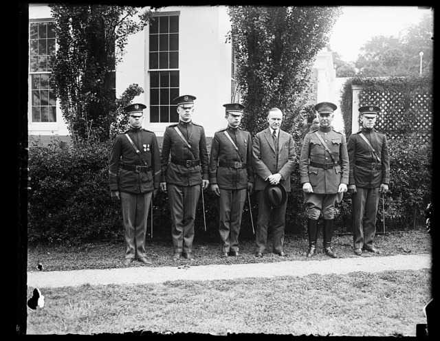 Committee from the high school cadets with Pres. Coolidge, Lt. Col. Ford W. Sammis, Lt. Col. C.M. Irelan, L.P. Baird, Pres Coolidge, Col. W.M. Craigie, USA, Pro. of Military Tactics of the High School Cadets, and Lt. Col. C.N. Hisle [White House, Washington, D.C.]