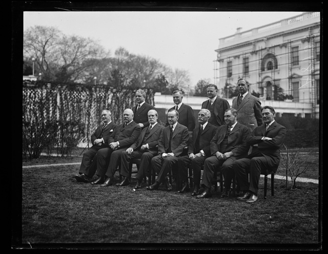 [Coolidge Cabinet outside White House. Front row, left to right: Henry Stewart New, John W. Weeks, Charles Evans Hughes, Calvin Coolidge, Andrew Mellon, Harlan F. Stone, and Curtis D. Wilbur. Back row, left to right: James J. Davis, Henry C. Wallace, Herbert Hoover, and Hubert Work]