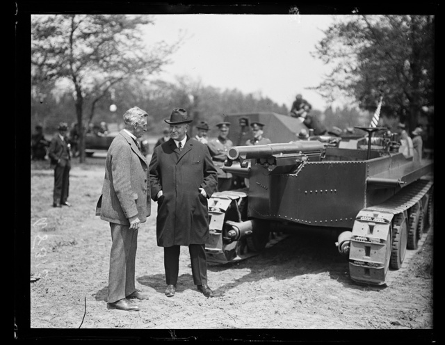 [Edwin Denby? with military tank]
