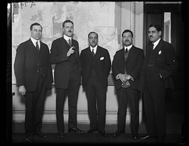 F.M. Moussa, Attache of the [...] Legation, right, introduced 2 noted [...] engineers to Allen Welsh Dulles, Chief of the Near Eastern Div. of the State Dept. The 2 engineers are K. Faki Wassef, and [...] Rifai, 3rd from left
