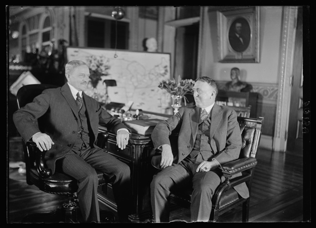 Gen. John J. Pershing, Chief of Staff, at his desk in the War Dept. for the first time since his return from France, conferring with Major Cen. John L. Hines, Deputy Chief of Staff