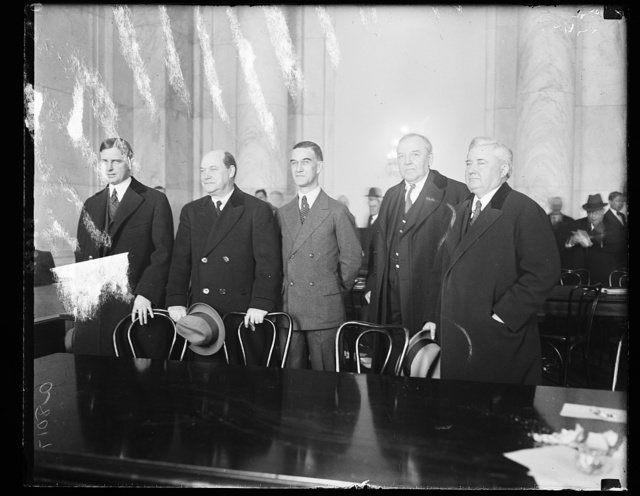 Harry F. Sinclair, multimillionaire oil magnate and his counsel at the Teapot Dome hearing, March 21st. Sinclair's counsel, led by Martin W. Littleton of N.Y., waged a 2 hr. legal battle with the oil committee in an efford to have their client excused from further questioning. Left to right: Martin W. Littleton, Col. J.W. Zevely, J.W. Simpson, Vice- Pres. of the Sinclair Oil Corp., Harry F. Sinclair, and G.T. Stanford