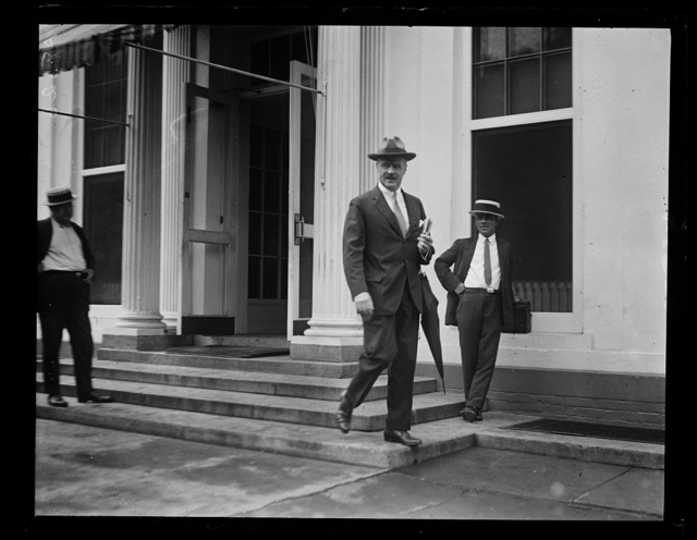 J. Butler Wright, third Asst. Secy. of State, arriving at the W.H. [i.e., White House] with letters of condolence for the Pres. from the State Dept. on the death of Calvin Coolidge, Jr.