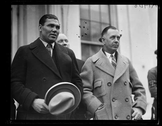 Jack Dempsey, World's Heavyweight Champion, left, and his Manager Jack Kearns