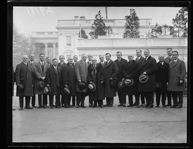 Members of Executive Committee of the American Banker's Assoc. who conferred with Pres. Coolidge on financial matters Dec. 11. William E. Knox, Pres. of the A.B.A. is standing center [White House, Washington, D.C.]