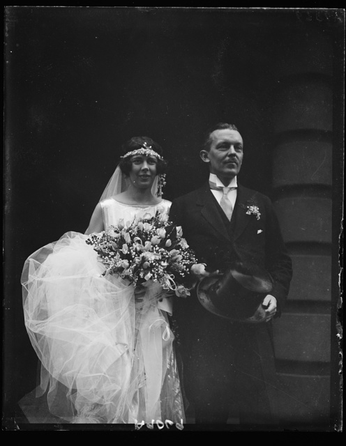 Mr. and Mrs. Sommerville Pinckney Tuck, leaving St. Thomas' Church, Wash., following wedding ceremony, Oct. 25. Mrs. Tuck, nee Beatrice Beck, daughter of the Solicitor Gen. and Mrs. Jas. M. Beck