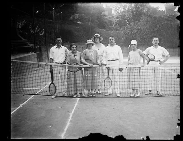 Mr. Yung Kwai of China, Mlle. Lutfia Yousry, daughter of Egyptian Minister, Miss Elizabeth Hughes, daughter of Secy. of State, Countess Sommati di Mombello, Capt. Varona, Mme. Tilmont and Col. Bernezzo of Italy, on Mrs. John B. Henderson's tennis court