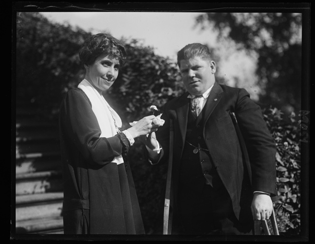 Mrs. Coolidge receiving the first Forget-me-Not from Leo B. Clark, wounded veteran, to be worn on Disabled Amer. Veterans Day, Nov. 8th [White House, Washington, D.C.]
