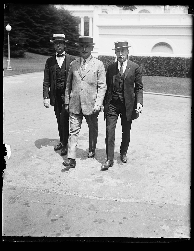 Officers of the Nat'l Federation of Post Office employees called on Pres. Coolidge, June 5, to urge the passage of a bill raising the pay of 350,000 Post Office Clerks before Congress adjourns. Left to rt.: Leo. E. George, Thos. F. Flaherty, and Louis C. Woolf
