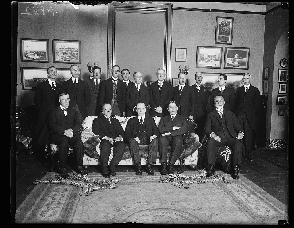 Officials and members of Dip. Corps guests at luncheon given by Dr. L.S. Row, Dir. Gen. of Pan-Amer. Union, in honor of Peruvian Ambassador Dr. Herman Velarde. Front row, left to rt.: Secy. Wallace, Amb. Velarde, Secy. Hughes, Secy. Wilbur, Dr. Jose F. Cavero. Back row: Dr. L.S. Rowe, Admiral Leigh D. Palmer, Francis White, Dr. Manuel Gamio, Eugene M. Gomez Maillerfert, James M. Beck, Solicitor Gen. Willis C. Cook, Amer. Minister to Venezuela Dr. J. C. Marriam, Vice-Pres. Nat'l Academy of Sciences Dr. Juan J. Mendoza, Hector Velarde and Dr. E. Gil Borges