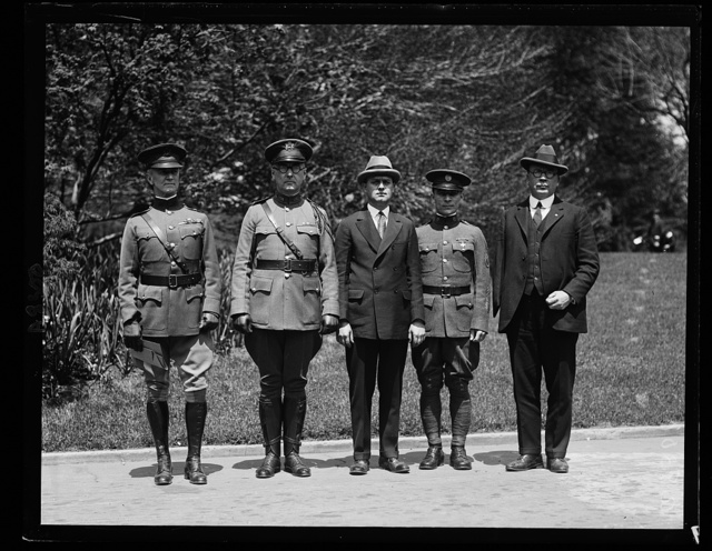 Pres. Coolidge, who will make the dedication of the 1st Div. Memorial Monument in Wash. in Oct., was today made an Honorary Member of the Society of the 1st Div. A.E.F., District of Columbia Branch. Left to right: Col. James A. Drain, Sgt. David Friesel, Capt. C.S. Ryan, Capt. C.S. Coulter and Gen. Frank H. Parker.