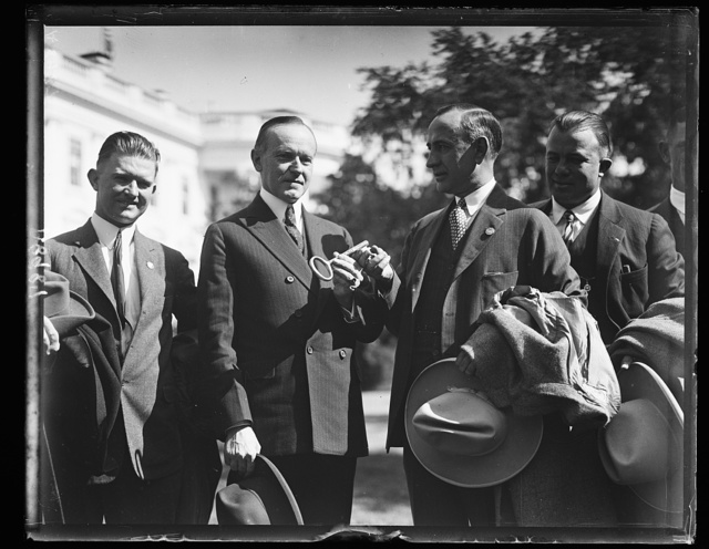 [Pres. Coolidge with the champion home-run hitter of the minor leagues]