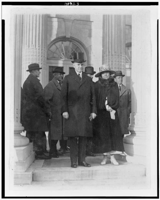 [President and Mrs. Coolidge leaving D.A.R. Hall after attending meeting of the Budget Committee]