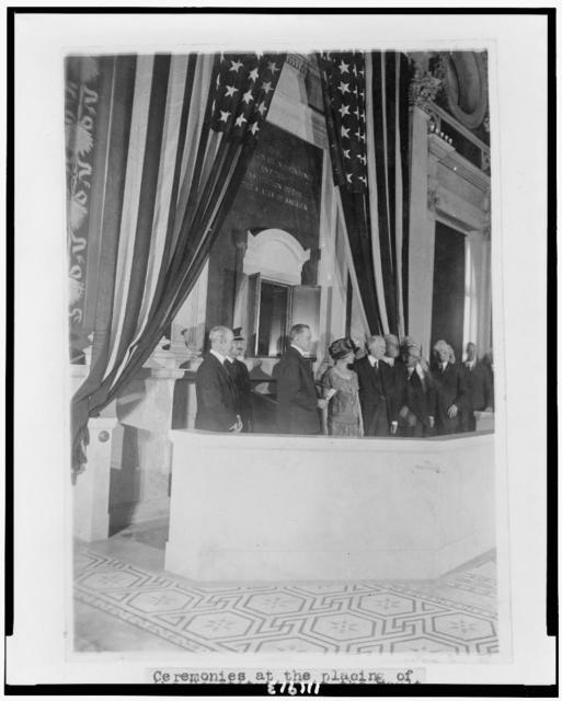 [President and Mrs. Coolidge with Herbert Putnam and others during ceremony when the Constitution was placed in the vault at the Library of Congress]