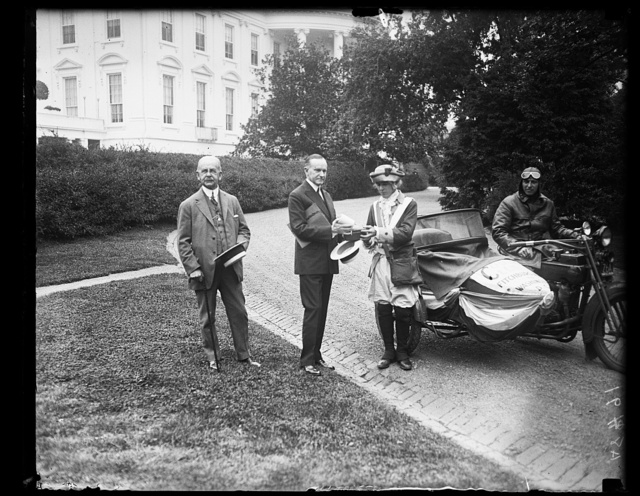Rep. Calvin D. Paige introduces J. Fancis Mahoney, the minute man, and John B. Camacho, escot of Fitchburg, Mass., who brought on a motorcycle the signatures of 7000 members of the Calvin Coolidge Club of that city [White House, Washington, D.C.]