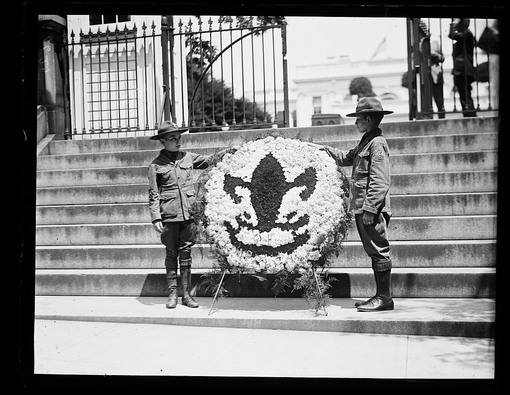 Robert Fulton, left, and Louis Paulin, who brought this huge wreath to the W.H. [i.e., White House] as a mark of sympathy from the Boy Scouts of America