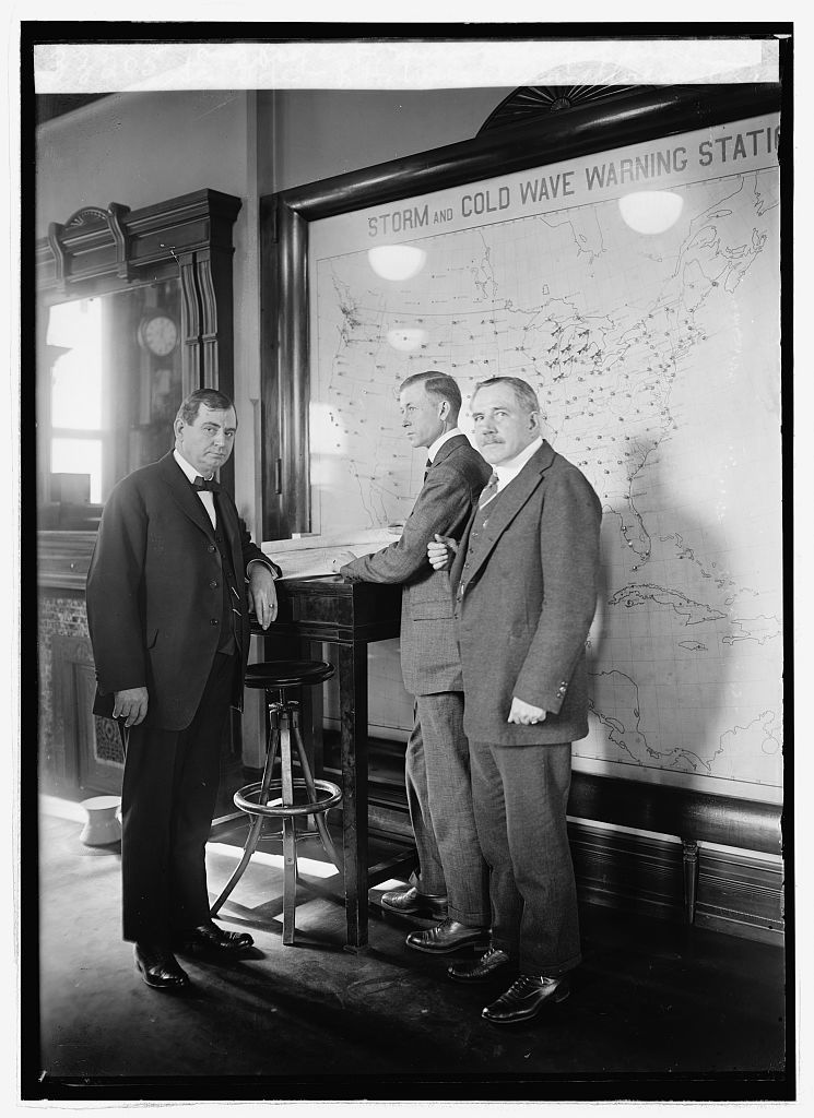 Sec. Gore, R.H. Weightman forecaster and Prof. C.F. Marvin, Chief of Bu.