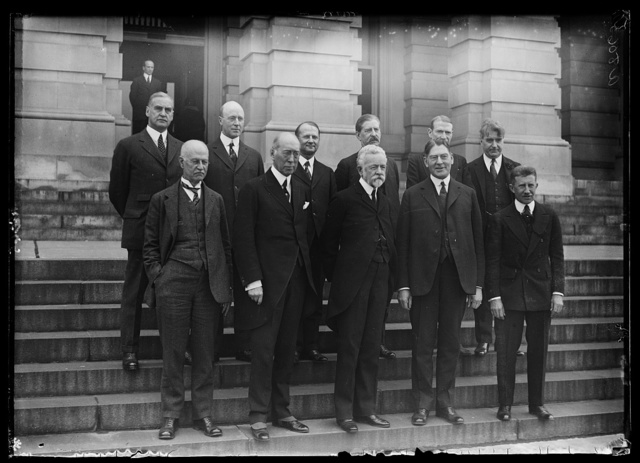 Secy. of Navy Curtis D. Wilbur was the guest of Senate Naval Affairs Committee luncheon. Left to right, front row: Senators O.E. Weller of Md., S.M. Shortridge of Calif., Henry C. Lodge of Mass., Secy. Wilbur, and Frederick Hale of Maine. Left to right, back row: George W. Pepper of Pa., Tasker L. Oddie of Nev., Tasker L. Oddie of Nev., E.S. Broussard of La., C.A. Swanson of Va., Edward I. Edwards of N.J., and Royal S. Copeland of NY