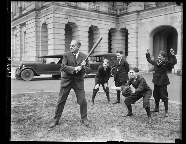 Sen. Pepper of Pa. got into baseball practive with the Senate Pages March 26 on the Capitol grounds. Sen. Pepper at bat