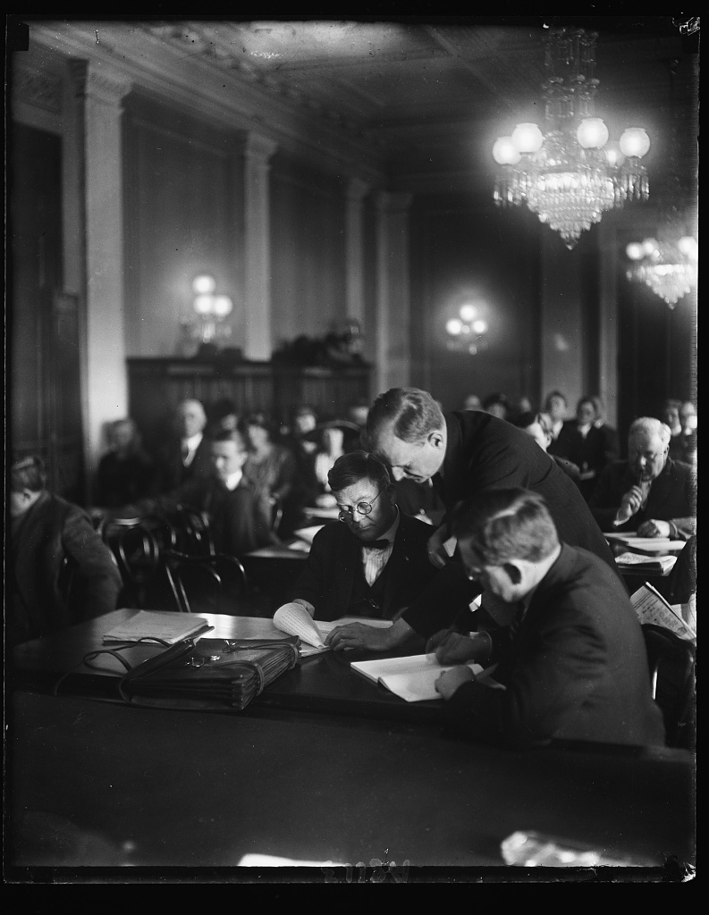 Senate prober at work. Sen. Burton K. Wheeler, chmn. of the Senate comm. investigating the Dept. of Justice, looking over testimony of Edwin S. Booth, special Asst. to the Atty. Gen., who appeared before the comm. April 7