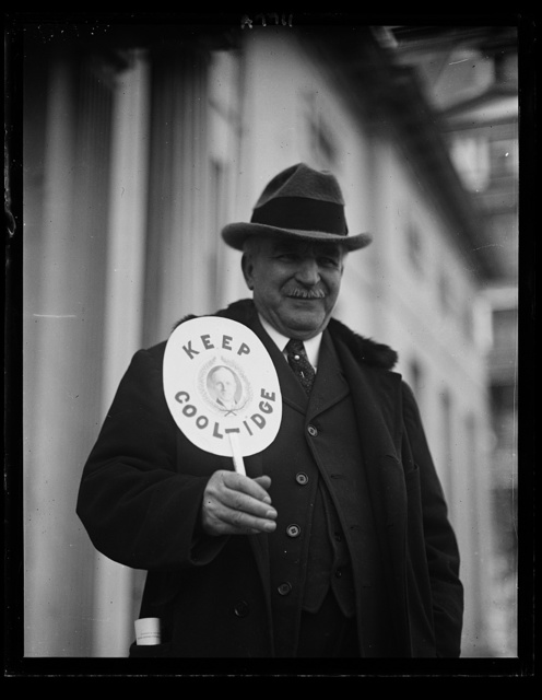 "T.G. Thomas of the U.S. Soldiers Home with a fan he has invented for Rep. Convention next June. It reads ""Keep Cool...Idge"""