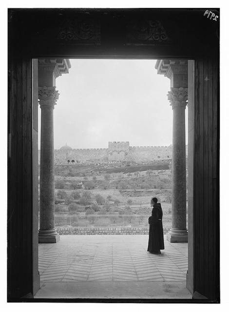 The Basilica of Gethsemane [i.e., Church of All Nations or Church of the Agony]. View from portico showing city wall & the Golden Gate.