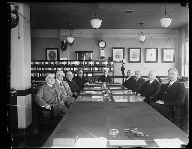 These naval officers compose the Naval board that convened June 2 for the purpose of selecting 7 new Admirals, 22 Captains and 42 Commanders. Board is headed by Adm. E.W. Eberle, left to rt. around the table: Read Admirals Wm. R. Shoemaker, H.P. Jones, M.S. Johnston, Admirals E.R. Coontz, Ed. W. Eberle, Pres. of the Board, S.S. Robison and Rear Admirals C.S. Williams, J. Strauss and C.S. Hughes