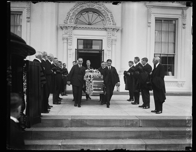 [... through a lane of cabinet members by honorary pall bearers. To Arlington Nat'l Cemetery. White House, Washington, D.C.]