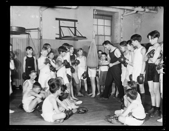 Wm. R. Whipp, Physical Instructor at the Racquet Club in Wash., demonstrating art of self-defense to sons of Dip. and Sen. [...]