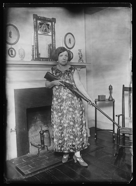 [Woman with rifle]