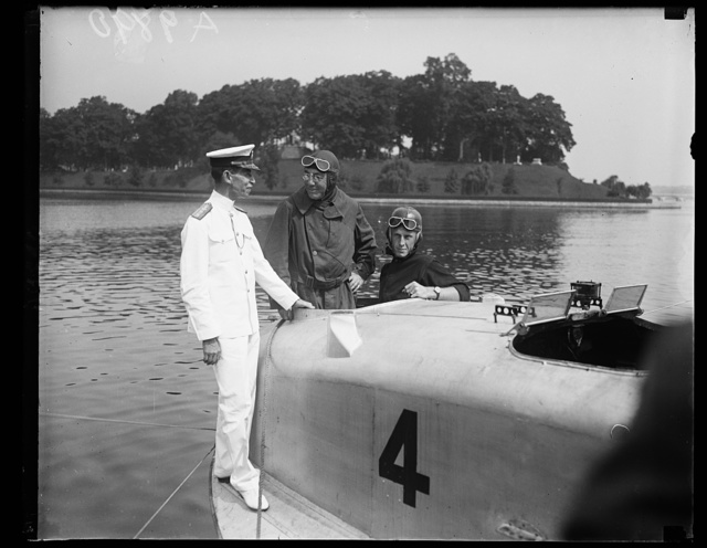 Assistant Secretary of the Navy Theodore Douglas Robinson, inspected the new training being given the Midshipmen at the U.S. Naval Academy, Annapolis, Md on Friday August 7th. Under the new regulations each midshipmen must take a course in aviation and learn to pilot a plane. The [...] Year Men now at the Academy are the first ones to recieve training. This picture shows Mr. Robinson (center) ready [...]ake a flight with Midshipman C.O. Larson, right. Admiral N[...] Superintendent of the Academy