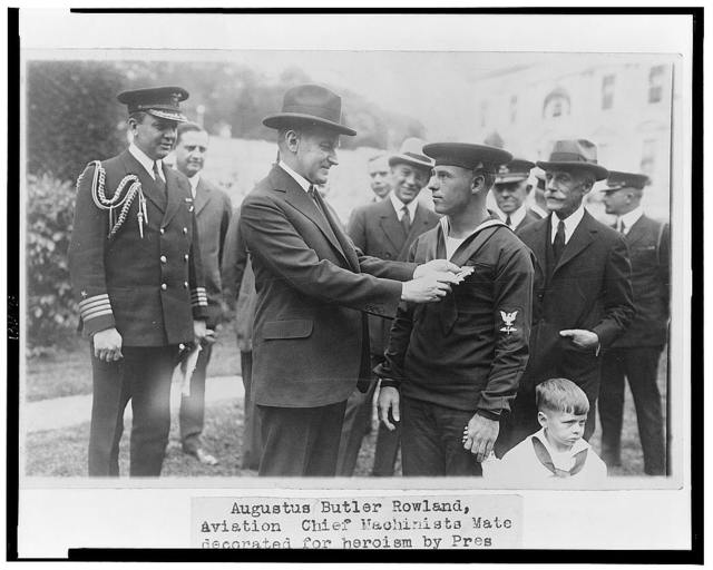 Augustus Butler Rowland, Aviation Chief Machinists Mate, decorated for heroism by Pres. Coolidge