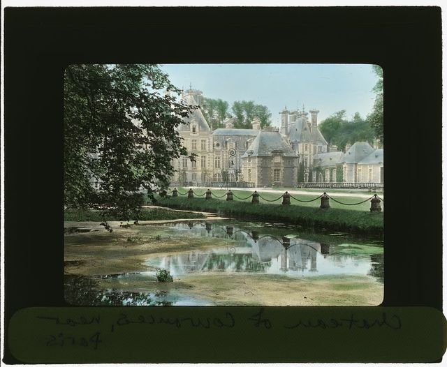 [Chateau of Courances, Courances, Seine et Marne, France. View to castle from canal]