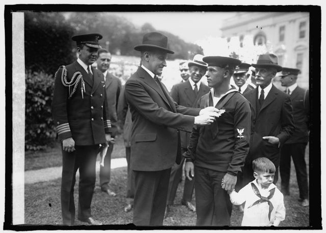 Coolidge decorating aviation chief mach. mate Augustus Butler Rowland, [4/29/25]