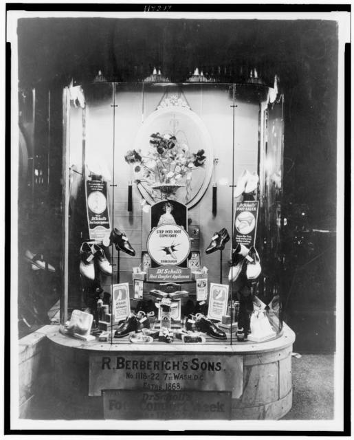 """Display of Dr. Scholl's shoes and """"foot comfort appliances"""" in the window of R. Berberich's Sons, a store in Washington, D.C."""