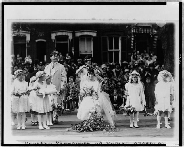 [Dorothy Zimmerman, as Spring, crowning Irma Sweeney as the May Queen at the May Day festival at the Neighborhood House, Washington, D.C.]