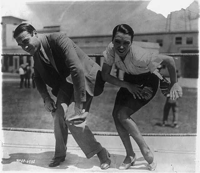 "[Frank Farnum - probably not the Western star Frank Farnum - coaching Pauline Starke to do the Charleston for the movie ""A Little Bit of Broadway"" (release title ""Bright Eyes""). May 9, 1925]"