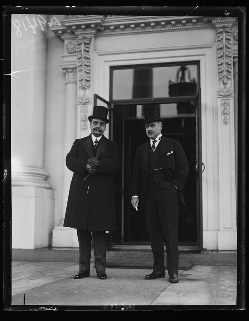 Hannibal Price, the new Minister from Haiti, (left), who presented his credentials to President Coolidge, February 10th. The new Minister was introduced to the President by Assistant Secretary of State J. Butler Wright, shown at the right [White House, Washington, D.C.]