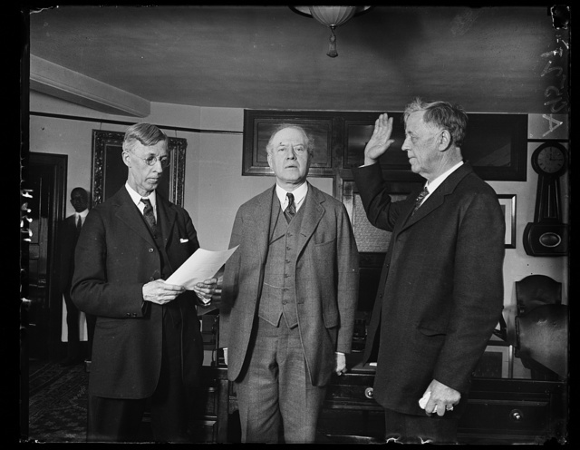 In less than 30 min. from the time he arrived at the Union Station, Wash., March 18, John G. Sargent of Vermont, was sworn in at the Dept. of Justice as Atty. Gen. of the U.S. Oath taking. C.B. Sornborger (left) Appointment Clerk delivered the oath. Rush L. Hollard, Asst. Atty. Gen., in center