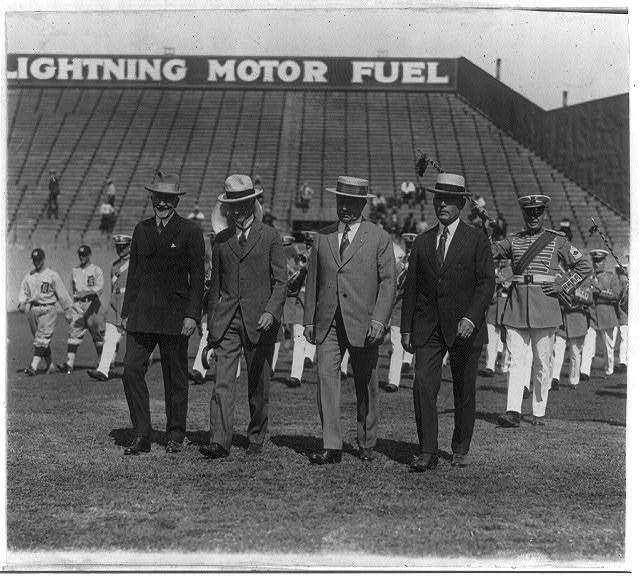 Judge Landis and 3 others leading procession at Griffith stadium for pennant flag-raising ceremony