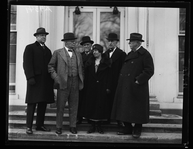 Looking after the red man. Members of the Board of Indian Commissioners, holding their annual meeting in Washington, make their report to President Coolidge and are photographed at the White House. Left to right in the group are: Samuel A. Eliot, Cambridge Mass.; General Hugh L. Scott, Princeton, N.J.; Edgar E. Ayer, Chicago; Mrs. Flora Warren Seymour, Chicago; Malcolm McDowell, Secretary of the Board, Washington, D.C., and Daniel Smiley, Mohonk Lake, N.Y.