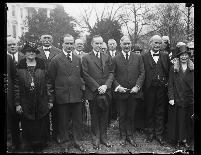Members of the Gen. Council of Presbyterian Churches call on Pres. Coolidge, March 18th. On the left of the Pres. is Dr. C.E. Macartney, Pres. General Assembly of [Presbyterian?] Churches and on his right is Dr. L.S. Mudge, Secy. of the [...] organization [White House, Washington, D.C.]