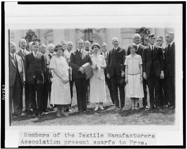 Members of the Textile Manufacturers Association present scarfs to Pres. and Mrs. Coolidge