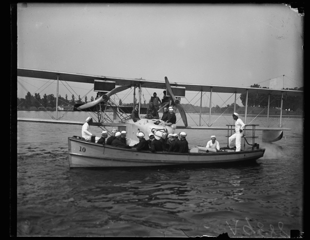 Midshipmen of the U.S. Naval Academy, (Ist year men) being carried by boat to the plane in which they take daily flights and study each and every part of the mechanism. These are the first men to receive this training under the recent orders, providing for a course in aviation