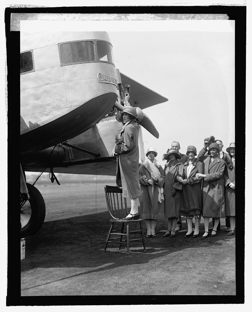 Miss Elizabeth Owens christens Sikorsky plane, [5/8/25]