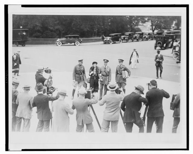 Mitchell, his wife, and aides being photographed before going into the Morrow Aviation Board, Sept. 29, 1925