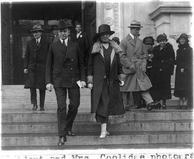 "Pres. and Mrs. Coolidge photographed leaving the Corcoran Gallery of Art where they viewed ""The Only Hope,"" a picture by Georges Innes, Jr., N.A."