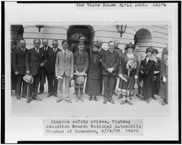 [President and Mrs. Coolidge with winners of safety prizes of the Highway Education Board, National Automobile Chamber of Commerce]